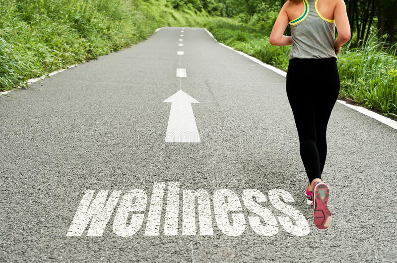 Concept illustrating with running girl on the road the wellness. And good health royalty free stock photo