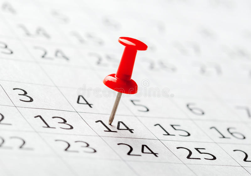 Concept image of a calendar with red push pins. Image of a calendar with red push pins royalty free stock photo