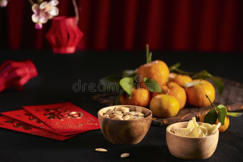 Concept image of the lunar new year - mandarin orange, jam and red packet. Text on envelop means Happy New Year and Happiness stock photos