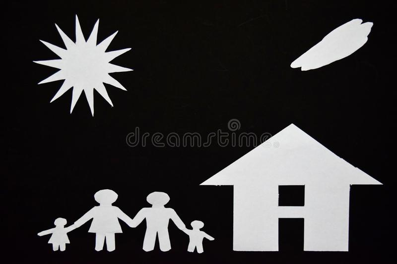 Concept image of make your a house. Paper cut of family with house and tree stock photos