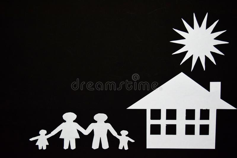 Concept image of make your a house. Paper cut of family with house and tree royalty free stock photos