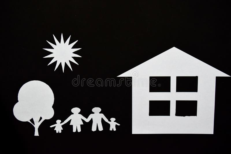 Concept image of make your a house. Paper cut of family with house and tree royalty free stock image