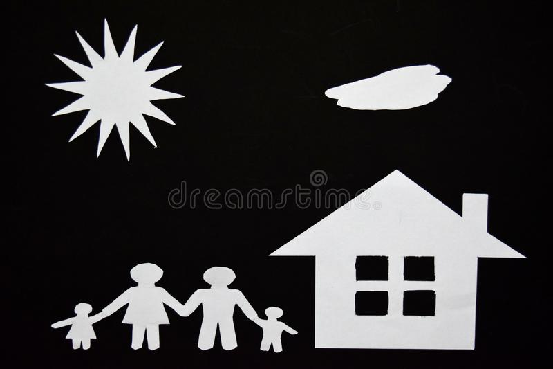 Concept image of make your a house. Paper cut of family with house and tree royalty free stock photography