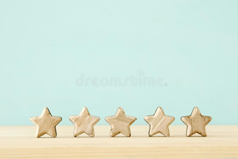 Concept image of setting a five star goal. increase rating or ranking, evaluation and classification idea. stock image