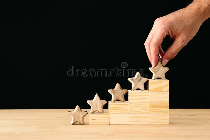 Concept image of setting a five star goal. increase rating or ranking, evaluation and classification idea. Concept image of setting a five star goal. increase stock photography