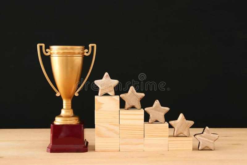 Concept image of setting a five star goal. increase rating or ranking, evaluation and classification idea. Concept image of setting a five star goal. increase royalty free stock photos