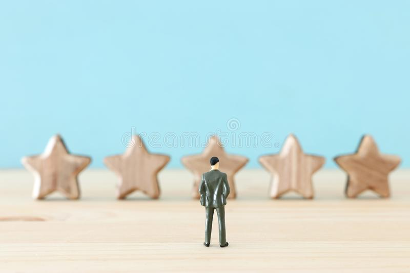 Concept image of setting a five star goal. increase rating or ranking, evaluation and classification idea. Performance management excellence experience review royalty free stock photography