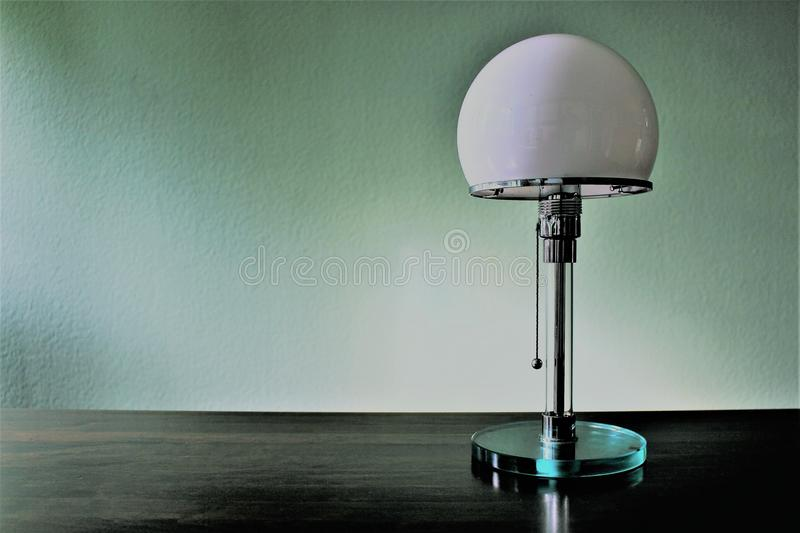 An concept image of a vintage designer lamp - bauhaus - with copy space royalty free stock photo