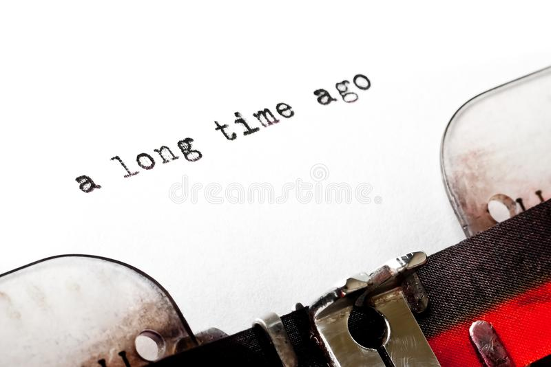 Concept image with word a long time ago printed. On an old typewriter stock photo