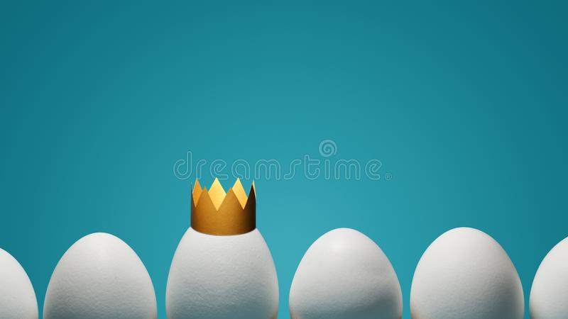 Concept of individuality, exclusivity, better choice. One white egg with golden crown among white eggs on blue background royalty free stock photography