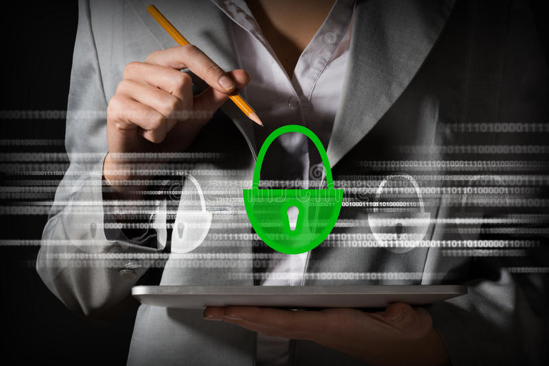 Concept of information security. Business woman checking safety on the Tablet PC royalty free stock photos