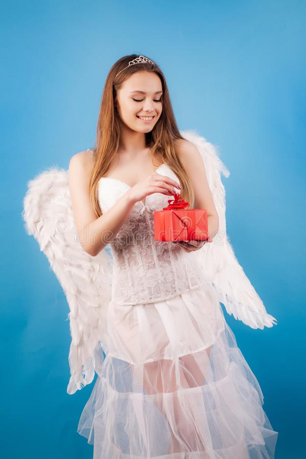 Concept of innocent girl. Love card. Valentines day. Cupid cute angel - Concept of Valentines Day. Love concept. Fashion. Glamour Halloween art design. Enjoying royalty free stock photo