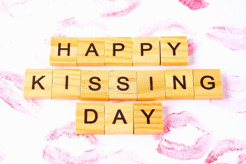 Concept for the International Day of Kisses. Lip prints on paper. And text Happy day kisses stock photos