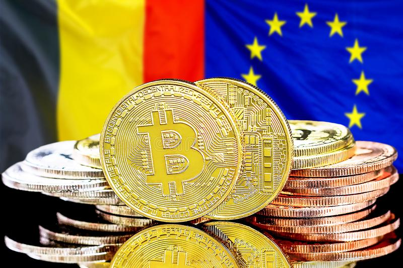 Bitcoins on Belgium and European Union flag background. Concept for investors in cryptocurrency and Blockchain technology in the Belgium and European Union stock photos