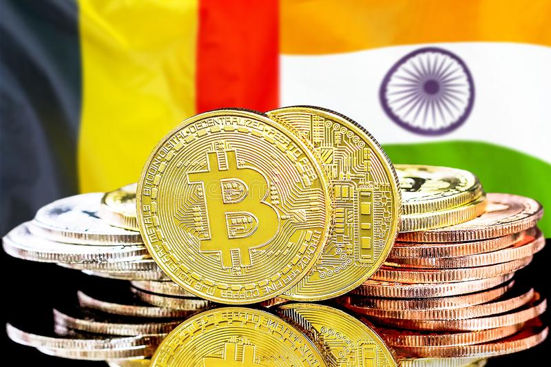 Bitcoins on Belgium and India flag background. Concept for investors in cryptocurrency and Blockchain technology in the Belgium and India. Bitcoins on the royalty free stock image