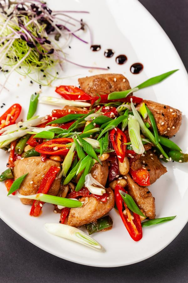 The concept of Japanese cuisine. Chicken fillet marinated in Japanese soy sauce with fresh vegetables, green beans, green onions stock photo