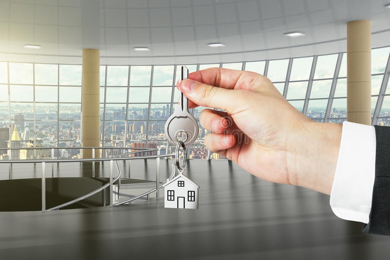 Concept of the keys to new large office with city view royalty free stock photos