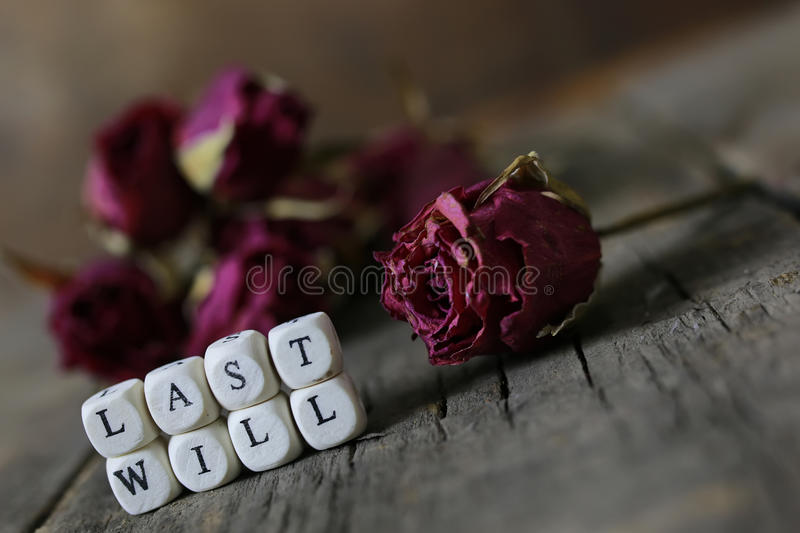 Concept last will and testament. Concept of last will and testament letters on a table stock photo