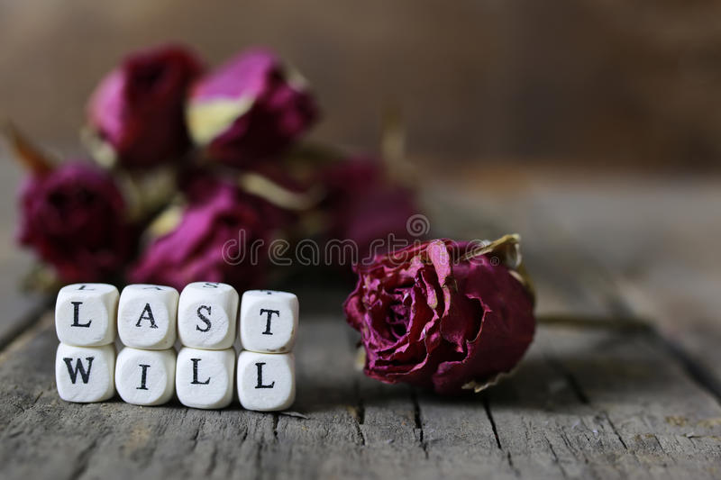 Concept last will and testament. Small wooden blocks with letters on them are laid in the floor on the old wooden table stock photo