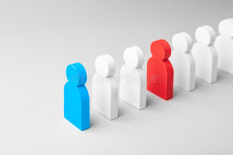 Concept leader of the business team indicates the direction of the movement towards the goal. Crowd of white men goes for leader. Concept leader of the business royalty free stock image