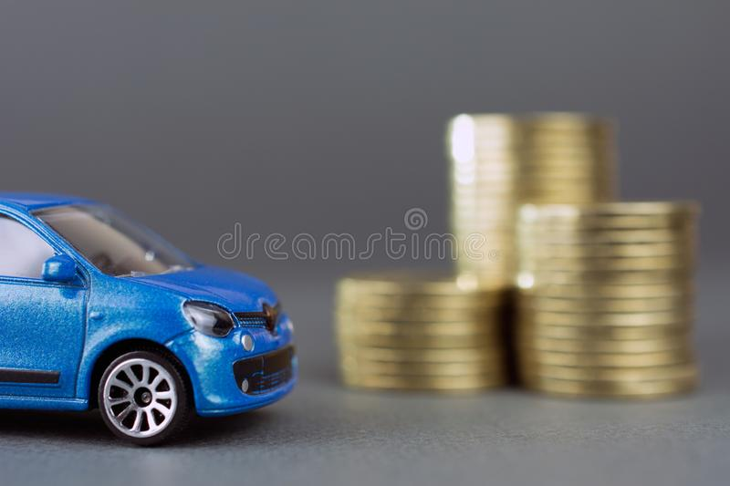 Toy car stack of coins royalty free stock image