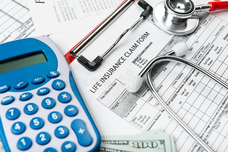Concept for life planning. Health insurance application form with banknote and stethoscope concept for life planning stock image