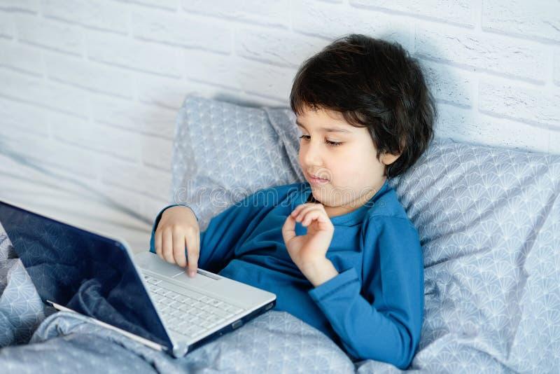Concept of little businessman, webmaster, programmer, developer, Website designer. Little child and laptop, computer notebook, internet, boy, happy, infant royalty free stock photography