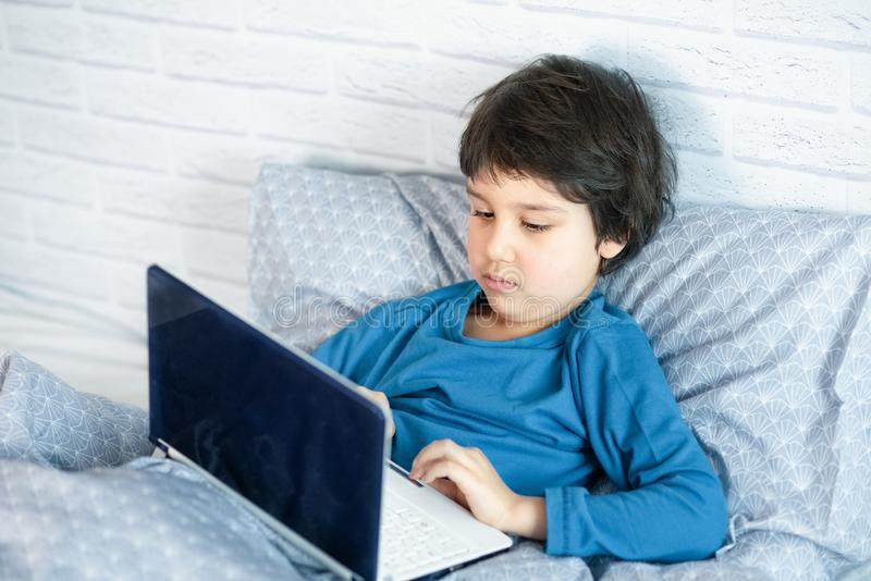 Concept of little businessman, webmaster, programmer, developer, Website designer. Little child and laptop, computer notebook, internet, boy, happy, infant stock photos