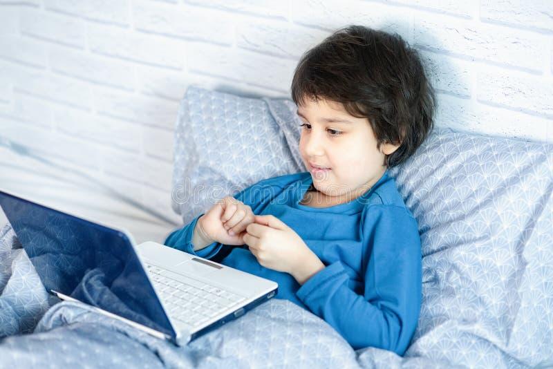 Concept of little businessman, webmaster, programmer, developer, Website designer. Little child and laptop, computer notebook. Child blogging in internet stock photos