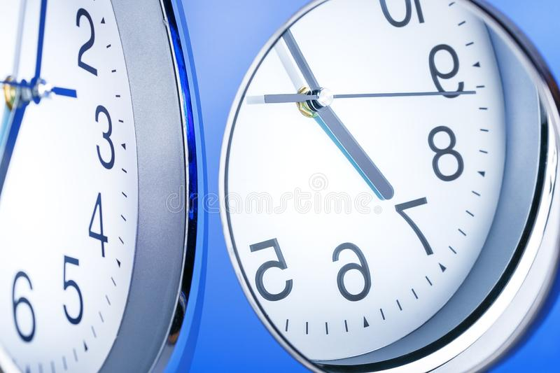 Time Passing. Reflection of clock face in the mirror. Concept of lost, cycle time. Concept of lost, cycle time. Time Passing. Reflection of clock face in the royalty free stock photos