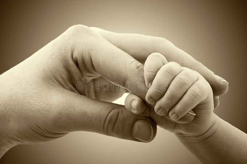 Concept of love and family. hands of mother and baby royalty free stock photos