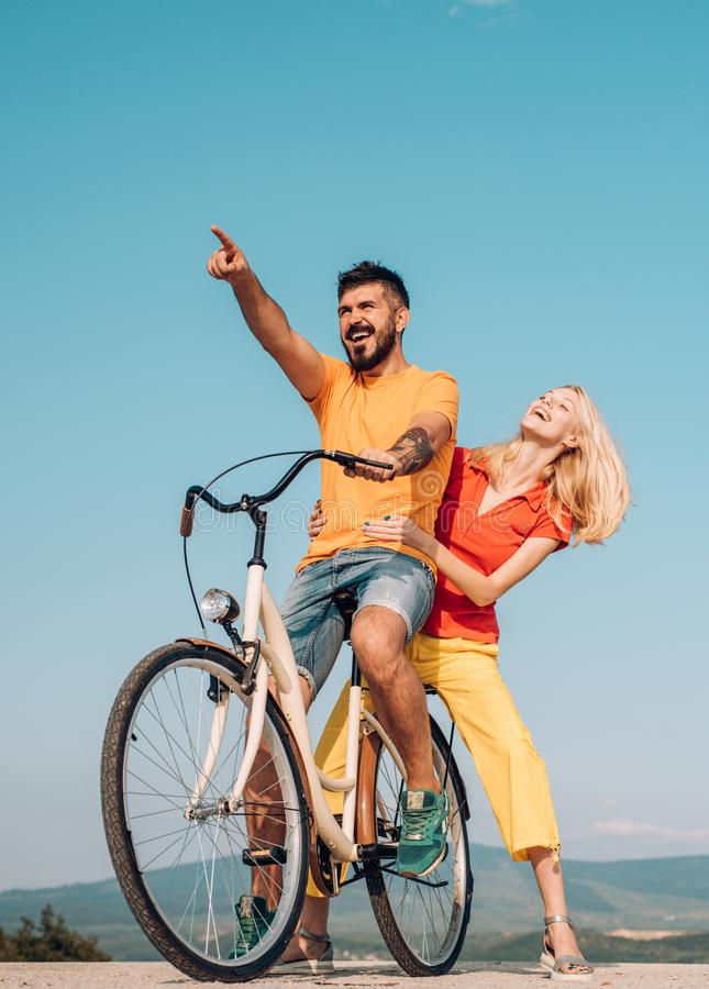 The concept of love and lifestyle. Summer love. Happy smiling young hippie couple outdoors. Couple with vintage bike royalty free stock images