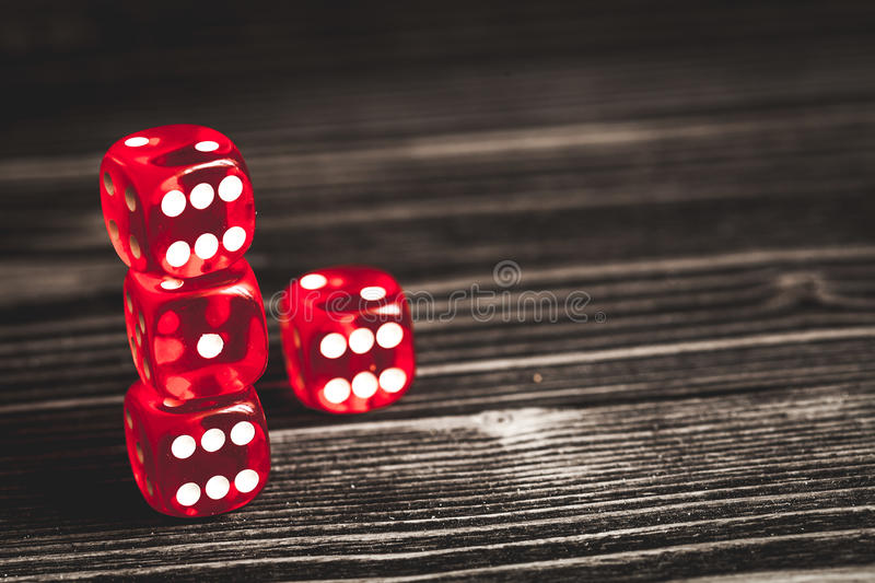 Concept luck - dice gambling on dark wooden background.  stock image