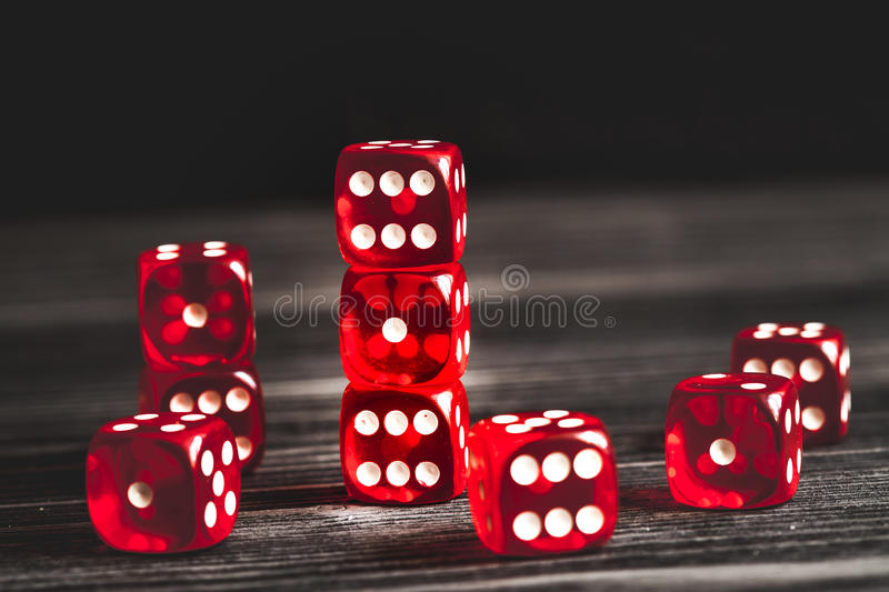 Concept luck - dice gambling on dark wooden background.  royalty free stock images