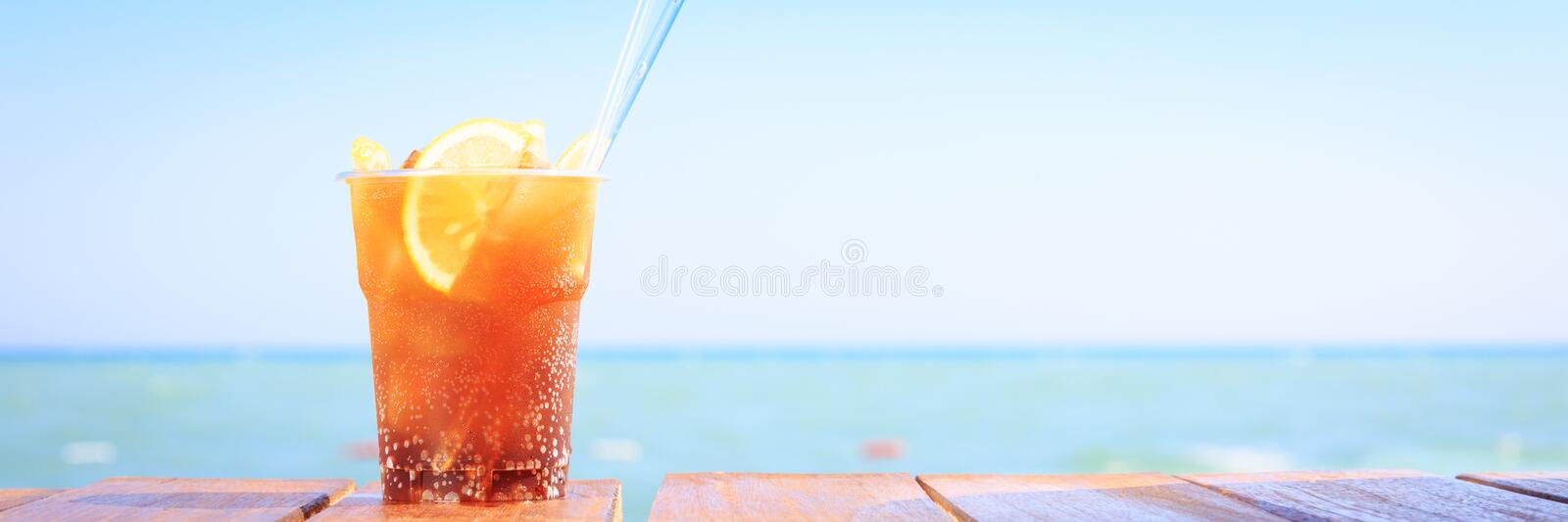 Concept of luxury tropical vacation. One Cuba Libre cocktail on. Concept of luxury vacation. Cuba Libre cocktail on the pier. Long island ice tea cocktail on the royalty free stock images