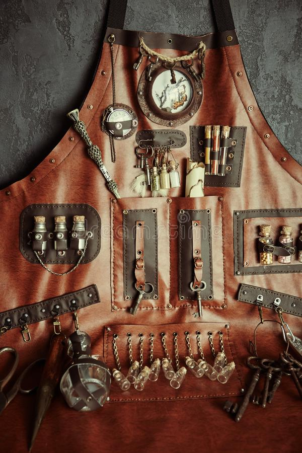 The concept of magic, witchcraft and alchemy. Apron with a set of items for witchcraft, making poisons and black magic.Composition royalty free stock images
