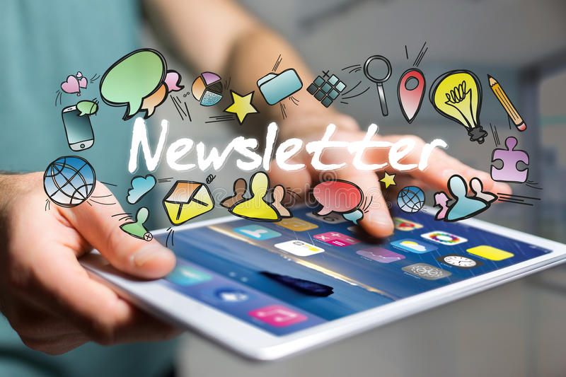 Concept of man holding futuristic interface with newsletter title and multimedia icons flying all around - Internet concept royalty free stock photography