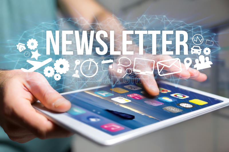 Concept of man holding futuristic interface with newsletter title and multimedia icons flying all around - Internet concept royalty free stock photos
