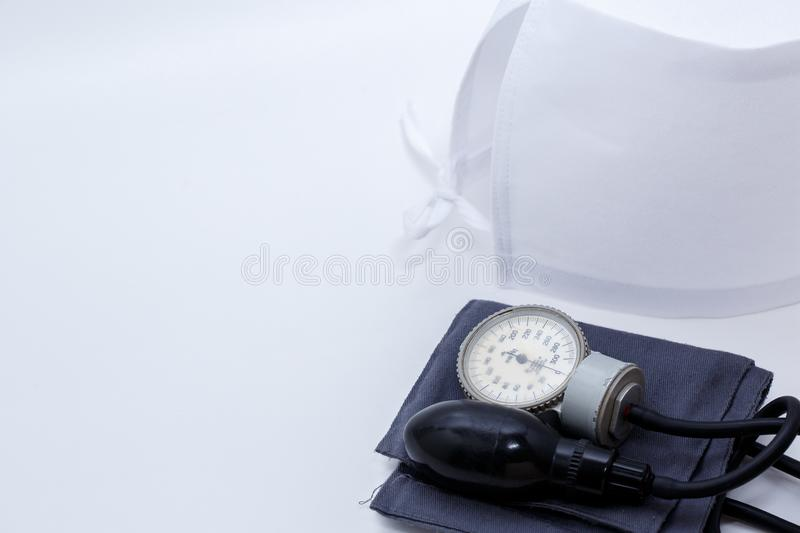 Concept for medicine. Medical items medical cap, tonometer, stethoscope on a white isolated background.  stock photo