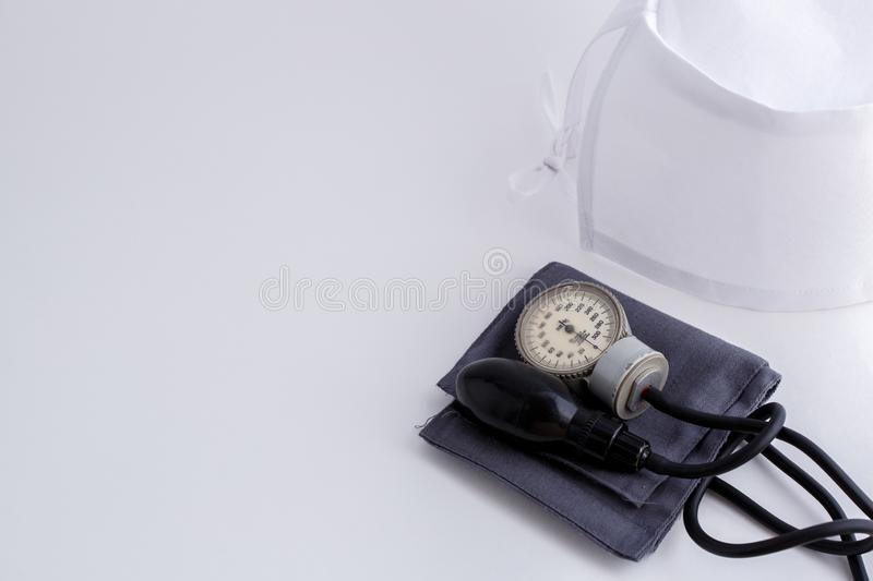 Concept for medicine. Medical items medical cap, tonometer, stethoscope on a white isolated background.  royalty free stock image