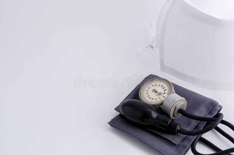 Concept for medicine. Medical items medical cap, tonometer, stethoscope on a white isolated background.  royalty free stock photography