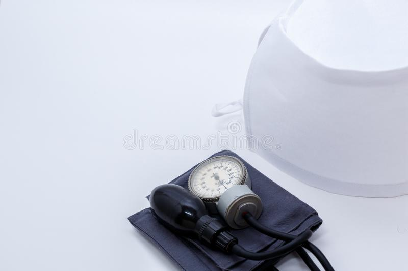 Concept for medicine. Medical items medical cap, tonometer, stethoscope on a white isolated background.  royalty free stock images