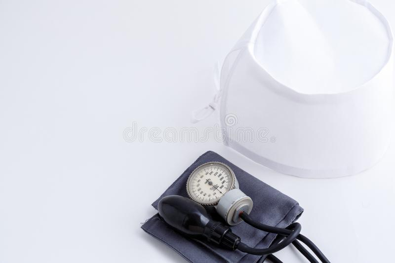 Concept for medicine. Medical items medical cap, tonometer, stethoscope on a white isolated background.  royalty free stock photo