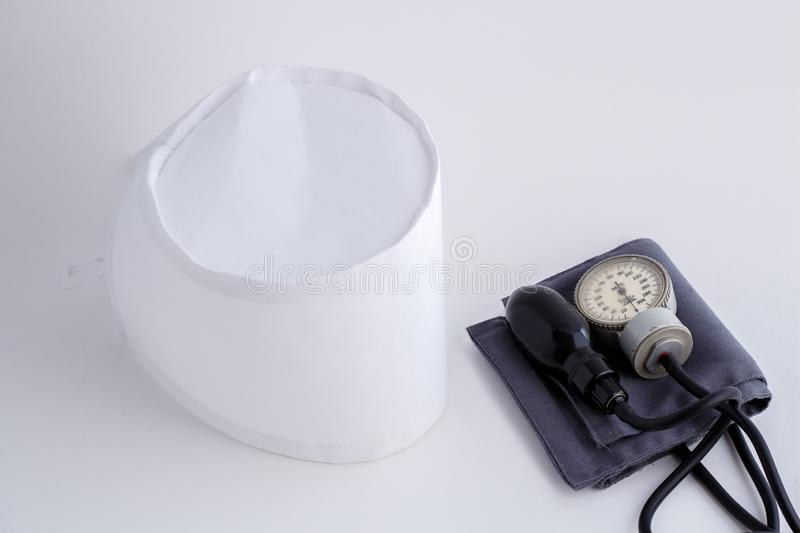 Concept for medicine. Medical items medical cap, tonometer, stethoscope on a white isolated background.  stock image