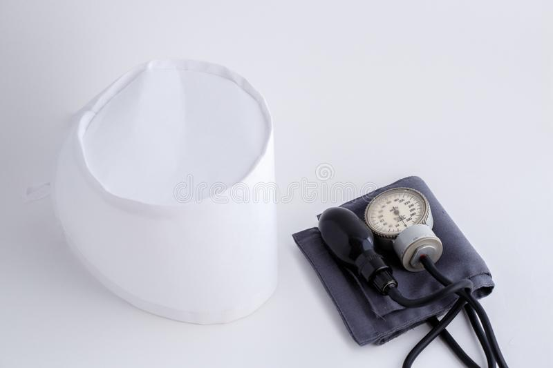 Concept for medicine. Medical items medical cap, tonometer, stethoscope on a white isolated background.  stock photos