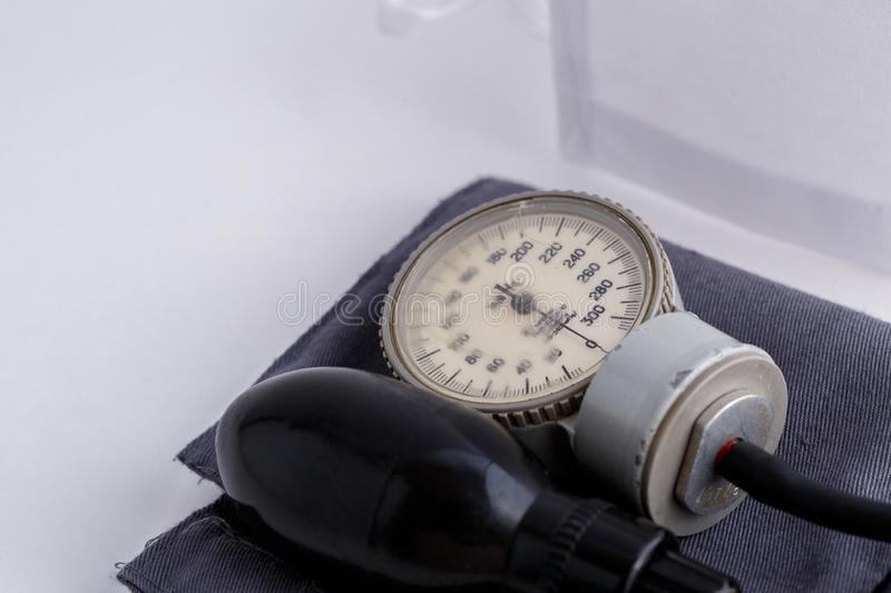 Concept for medicine. Medical items medical cap, tonometer, stethoscope on a white isolated background.  stock images