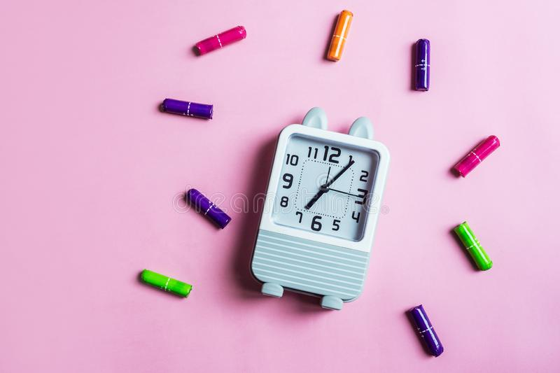 Tampons and clock. Concept for menstruation tampons and clock royalty free stock photo
