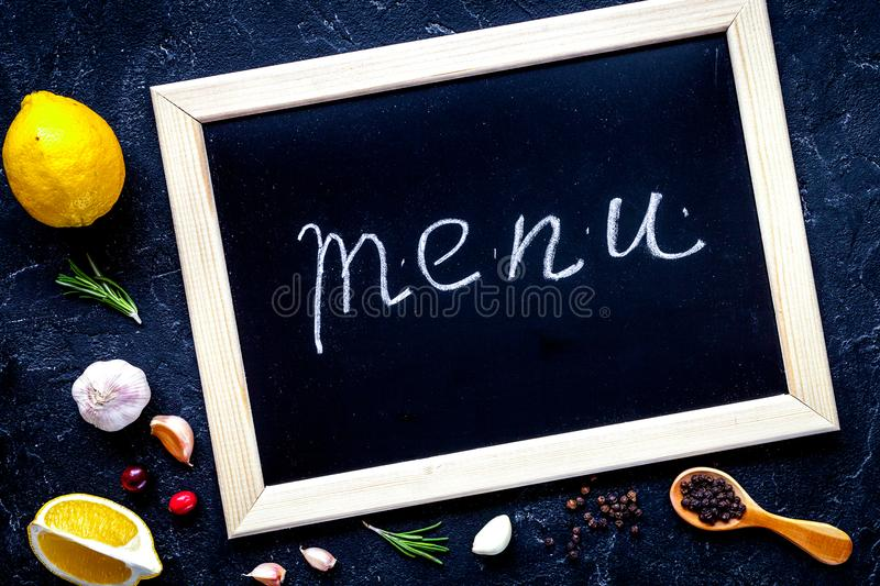 Concept menu composing on dark background top view.  royalty free stock photography