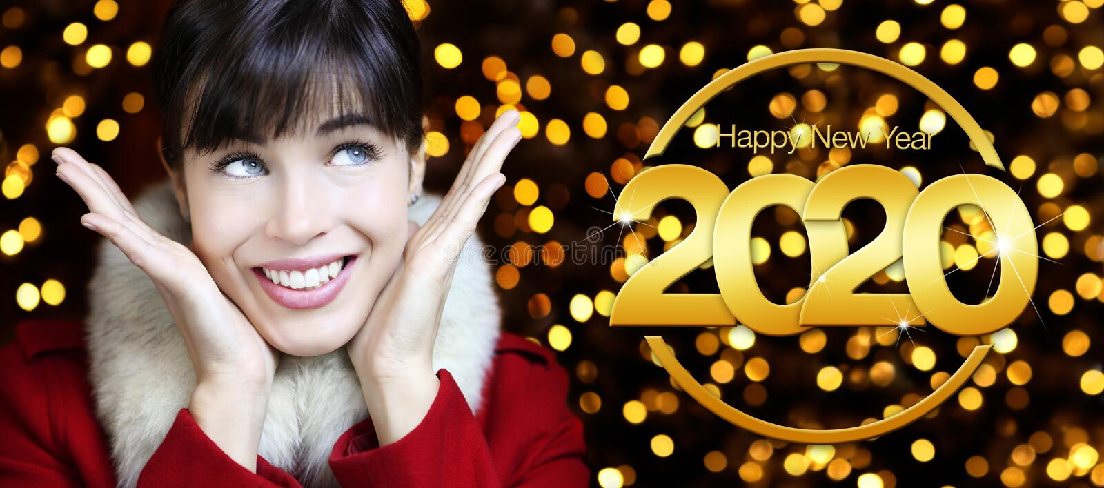 Concept of merry christmas and happy new year, surprise woman isolated on blurred lights background with ball and 2020 text royalty free stock photo