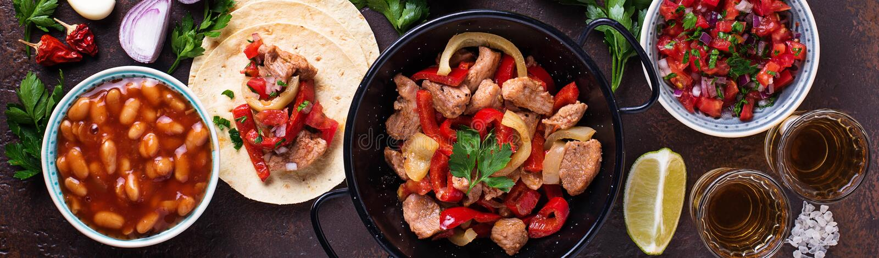 Concept of Mexican food. Salsa, tortilla, beans, fajitas and te. Quila. Top view, banner for site design stock photos